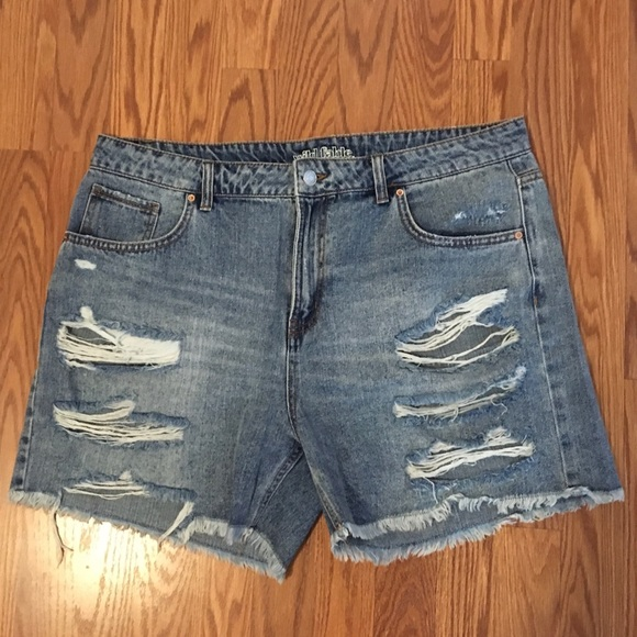 Torn jean shorts